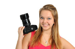 Beautiful girl holding a photo camera Stock Photo