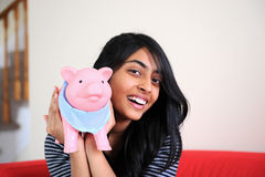 Beautiful girl holding piggybank Royalty Free Stock Image