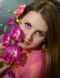 Beautiful girl holding a pink flower Royalty Free Stock Photography