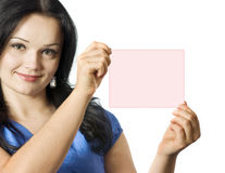 Beautiful girl holding pink sign Royalty Free Stock Images