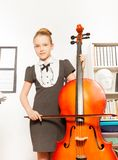 Beautiful girl holding and playing violoncello Stock Images