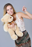 Beautiful girl holding plush bear toy Royalty Free Stock Photo