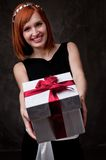 Beautiful girl holding a present Royalty Free Stock Image