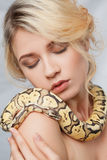 Beautiful girl  holding a python, which wraps Stock Image