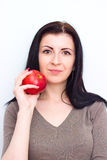 Beautiful girl  holding a red apple Stock Photos