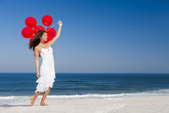 Beautiful girl holding red ballons Royalty Free Stock Photos