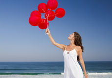 Beautiful girl holding red ballons Royalty Free Stock Images