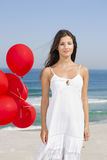 Beautiful girl holding red ballons Royalty Free Stock Photography