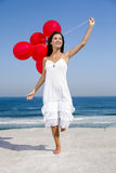 Beautiful girl holding red ballons Stock Photo