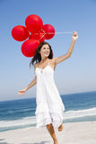 Beautiful girl holding red ballons Royalty Free Stock Photo