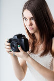 Beautiful girl holding a reflex camera Stock Photo
