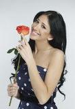 Beautiful girl holding a rose Stock Photos