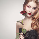 Beautiful girl holding a rose Royalty Free Stock Photo
