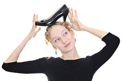 Beautiful girl holding a shoe Royalty Free Stock Photography