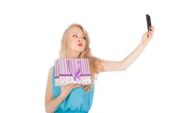 Beautiful girl holding shopping bags and taking selfie with cell phone Stock Photo