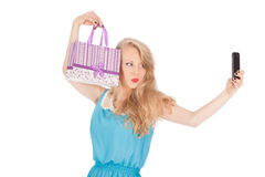 Beautiful girl holding shopping bags and taking selfie with cell phone Stock Image