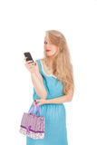 Beautiful girl holding shopping bags and taking selfie with cell phone Royalty Free Stock Image