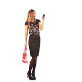 Beautiful girl holding shopping bags and taking selfie with cell phone isolated Royalty Free Stock Image
