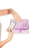 Beautiful girl holding shopping bags and taking selfie with cell phone isolated Stock Photo