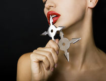Beautiful girl holding a shuriken Stock Photography