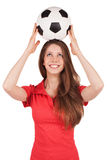 Girl holding a soccer ball on his head Royalty Free Stock Image