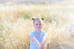 Portrait adorable little girl, age 9-10 on yellow autumn field. stock images