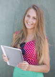 Beautiful girl holding tablet computer Royalty Free Stock Photo