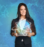 Beautiful girl holding a tablet with digital globe Stock Images