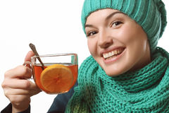Beautiful girl holding tea with lemon, recovery Royalty Free Stock Photos
