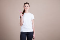 Beautiful girl holding a toothbrush Stock Images
