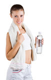 Beautiful girl is holding a towel and water bottle Royalty Free Stock Photo