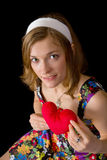 Beautiful girl holding toy heart Royalty Free Stock Images