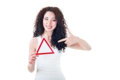 Beautiful girl holding triangular sign Stock Photography