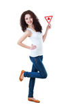 Beautiful girl holding triangular sign Royalty Free Stock Photo