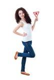 Beautiful girl holding triangular sign Royalty Free Stock Photo
