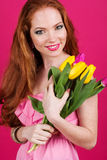 Beautiful girl is holding tulips, spring time Royalty Free Stock Images