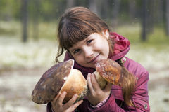 Beautiful girl holding two large white mushroom. Stock Images