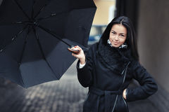 Beautiful girl holding umbrella in rainy day Stock Photography
