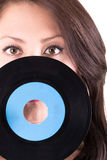 Beautiful girl holding a vinyl - on white Royalty Free Stock Images