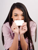 Beautiful girl holding a visit card. Royalty Free Stock Photos