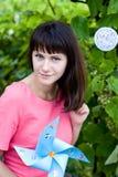 Beautiful girl holding a windmill Stock Photo
