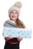 Beautiful girl holding a wrapped gift Royalty Free Stock Photo