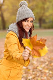 Beautiful girl holding yellow autumn leaves Royalty Free Stock Photography