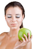 Beautiful girl holds in a hand green apple Stock Images