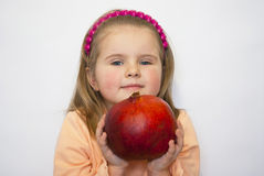 The beautiful girl holds a huge pomegranate in han Royalty Free Stock Photos