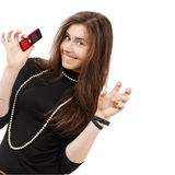 Beautiful girl holds playfully phone Stock Photos