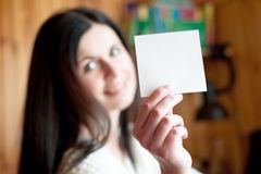 Beautiful girl holds a pure sheet of paper Stock Photography