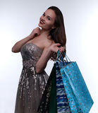 Beautiful  girl  holds shopping packs Royalty Free Stock Photo