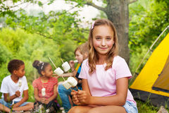 Beautiful girl holds sticks with marshmallows Royalty Free Stock Photography