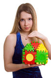Beautiful girl holds the toy house Royalty Free Stock Photo